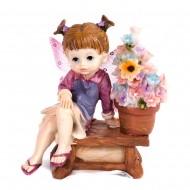 Статуэтка Феечка а скамье с цветами 12х11х5см